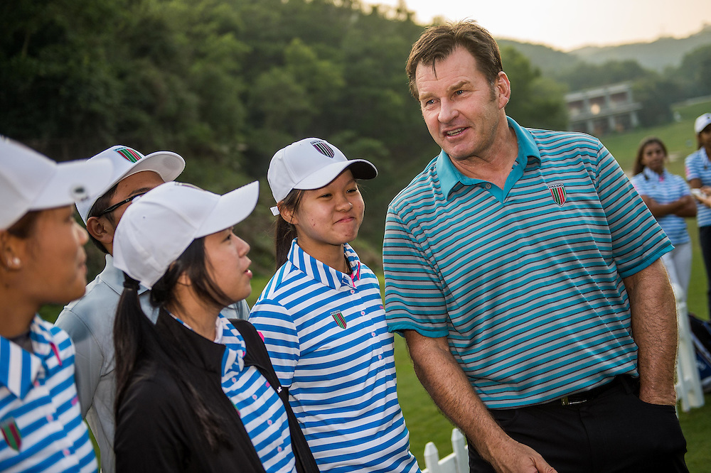 Partcipants attend the clinic by Sir Nick Faldo during day one of the 10th Faldo Series Asia Grand Final at Faldo course in Shenzhen, China. Photo by Xaume Olleros.