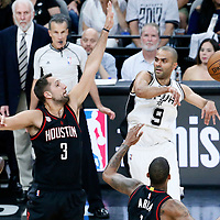 01 May 2017: San Antonio Spurs guard Tony Parker (9) passes the ball past Houston Rockets forward Ryan Anderson (3) and Houston Rockets forward Trevor Ariza (1) during the Houston Rockets 126-99 victory over the San Antonio Spurs, in game 1 of the Western Conference Semi Finals, at the AT&T Center, San Antonio, Texas, USA.