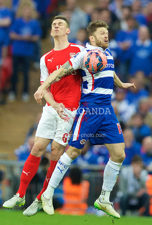 LONDON, ENGLAND - Saturday, April 18, 2015: Arsenal's Laurent Koscielny in action against Reading's Jamie Mackie during the FA Cup Semi-Final match at Wembley Stadium. (Pic by David Rawcliffe/Propaganda)
