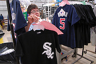 4/3/09 10:53:33 AM -- Easton, PA, U.S.A. -- Julie Hank, a worker at Majestic Athletic holds a Chicago White Sox tee shirt April 3, 2009 in Easton, Pennsylvania. White Sox jerseys and gear have experienced a boost in sales with Obama, a White Sox fan, in the White House. -- .Photo by William Thomas Cain,  cainimages.com.