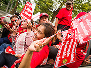 "10 DECEMBER 2012 - BANGKOK, THAILAND:  Red Shirt protestors start their motorcade in Bangkok Monday. The Thai government announced on Monday, which is Constitution Day in Thailand, that will speed up its campaign to write a new charter. December 10 marks passage of the first permanent constitution in 1932 and Thailand's transition from an absolute monarchy to a constitutional monarchy. Several thousand ""Red Shirts,"" supporters of ousted and exiled Prime Minister Thaksin Shinawatra, motorcaded through the city, stopping at government offices and the offices of the Pheu Thai ruling party to present demands for a new charter.        PHOTO BY JACK KURTZ"