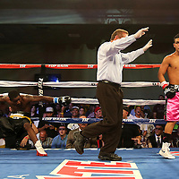 ORLANDO, FL - OCTOBER 04: Neslan Machado (R) walks to a neutral corner after he knocks out Stephon McIntyre during a professional featherweight boxing match at the Bahía Shriners Auditorium & Events Center on October 4, 2014 in Orlando, Florida. (Photo by Alex Menendez/Getty Images) *** Local Caption ***Neslan Machado; Stephon McIntyre