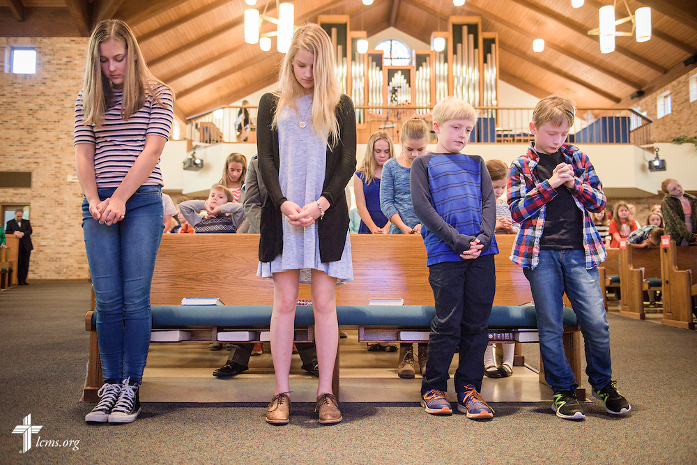 Students standing together from different grades pray during chapel on Friday, Oct. 28, 2016, at First Immanuel Lutheran School in Cedarburg, Wis. LCMS Communications/Erik M. Lunsford
