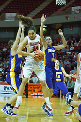 01 January 2011:  Hannah Spanich controls a rebound in a den of Panthers during an NCAA Women's basketball game between the Northern Iowa Panthers and the Illinois State Redbirds at Redbird Arena in Normal Illinois.