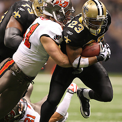 Dec 27, 2009; New Orleans, LA, USA;  New Orleans Saints running back Pierre Thomas (23) is tackled by Tampa Bay Buccaneers linebacker Barrett Ruud (51)during the first quarter at the Louisiana Superdome. Mandatory Credit: Derick E. Hingle-US PRESSWIRE..