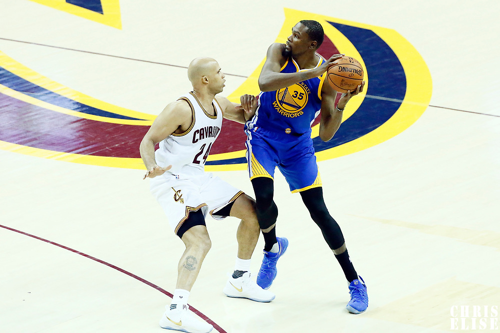 09 June 2017: Cleveland Cavaliers forward Richard Jefferson (24) defends on Golden State Warriors forward Kevin Durant (35) during the Cleveland Cavaliers 137-11 victory over the Golden State Warriors, in game 4 of the 2017 NBA Finals, at  the Quicken Loans Arena, Cleveland, Ohio, USA.