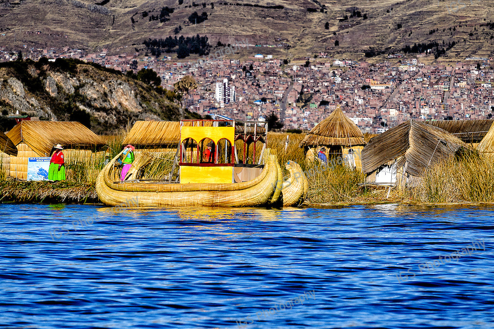 Floating islands of the Uros people, traditional reed boats and reed houses
