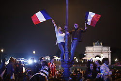 © Licensed to London News Pictures. 07/05/2017. Paris, France. Macron supporters celebrate after listening the newly elected French President Emmanuel Macron's at Louvre Museum in Paris, France as he wins the second round of the presidential election agaisnt the Front National's Marine Le Pen on Sunday, 7 May 2017. Photo credit: Tolga Akmen/LNP
