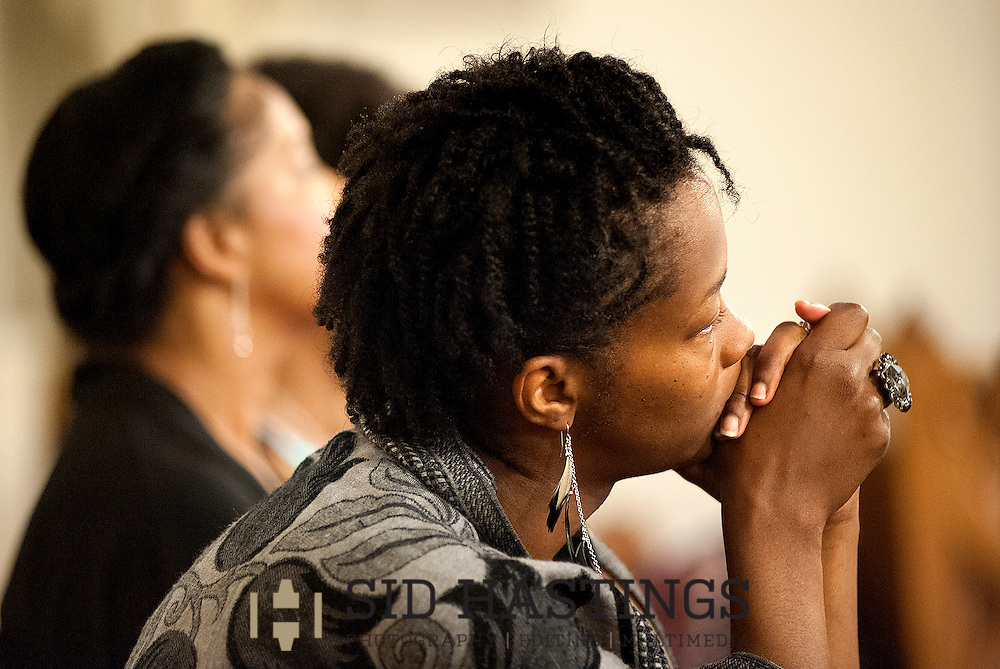 23 JUNE 2013 -- ST. LOUIS -- Melynie Blackshear listens intently during the Homily of The Most Rev. Edward M. Rice, Auxiliary Bishop of St. Louis, during a Mass dedicating the new Shrine of St. Peter Claver at St. Matthew the Apostle Catholic Church in The Ville neighborhood of St. Louis Sunday, June 23, 2013. Photo © copyright 2013 Sid Hastings.