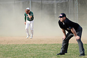 Shortstop Bo Berluti of Westwood covers his face with his glove as heavy winds blow across the field in Westwood's home game against Millis; April 14, 2014. (Wicked Local Staff Photo/ Sam Goresh)