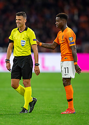 24-03-2019 NED: UEFA Euro 2020 qualification Netherlands - Germany, Amsterdam<br /> Netherlands lost the match 3-2 in the last minute / Referee Jesus Gil Manzano (ESP), Quincy Promes #11 of The Netherlands