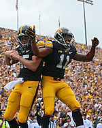 September 07 2013: Iowa Hawkeyes quarterback Jake Rudock (15) and Iowa Hawkeyes wide receiver Kevonte Martin-Manley (11) celebrate after a touchdown during the first quarter of the NCAA football game between the Missouri State Bears and the Iowa Hawkeyes at Kinnick Stadium in Iowa City, Iowa on September 7, 2013. Iowa defeated Missouri State 28-14.