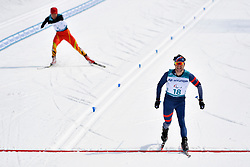 DAVIET Benjamin FRA LW2, MA Mingtao CHN LW5/7 competing in the ParaSkiDeFond, Para Nordic Skiing, 20km at  the PyeongChang2018 Winter Paralympic Games, South Korea.