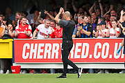 Rotherham United manager Paul Warne celebrating with crowd during the EFL Sky Bet League 1 match between AFC Wimbledon and Rotherham United at the Cherry Red Records Stadium, Kingston, England on 3 August 2019.