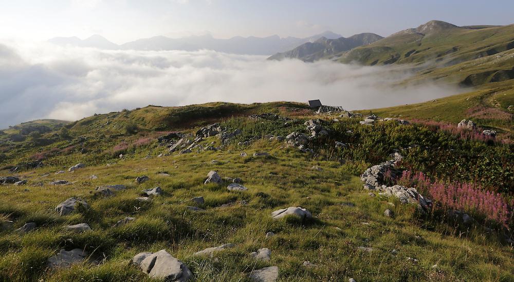 Morning mist raising up from the valle, katun Carine, below the Komovi mountains, Montenegro.  'Katun' is a mountain  summer settlement of pastolarists.