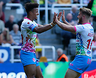 Regan Grace (L) of St Helens celebrates scoring his try with team mate Danny Richardson (R) against  Widnes Vikings during the Betfred Super League match at the Dacia Magic Weekend, St. James's Park, Newcastle<br /> Picture by Stephen Gaunt/Focus Images Ltd +447904 833202<br /> 19/05/2018