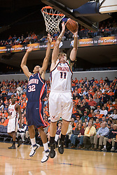 Virginia forward Laurynas Mikalauskas (11) beats Richmond forward Justin Harper (32) to the basket.  The Virginia Cavaliers men's basketball team defeated the Richmond Spiders 66-64 in the first round of the College Basketball Invitational (CBI) tournament held at the University of Virginia's John Paul Jones Arena in Charlottesville, VA on March 18, 2008.