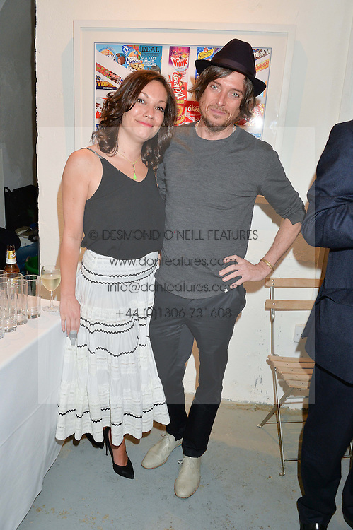 NATASHA ARCHDALE and DARREN STROWGER at a private view of an exhibition entitled 'All Shook Up' - by Natasha Archdale: A Retrospective held at 90 Piccadilly, London on 23rd April 2015.