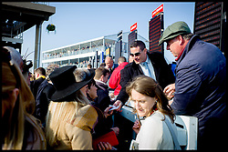 Bookmakers take bets before the start of  the Queen Mother Champion Steeple Chase at the Cheltenham Festival Ladies Day at Cheltenham Racecourse, Cheltenham, United Kingdom. Wednesday, 12th March 2014. Picture by Andrew Parsons / i-Images