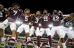 Texas A&M's Christian Kirk (3) sways along with teammates during the singing of the Aggie War Hymn after a 52-10 win over New Mexico State after in an NCAA college football game Saturday, Oct. 29, 2016, in College Station, Texas. (AP Photo/Sam Craft)