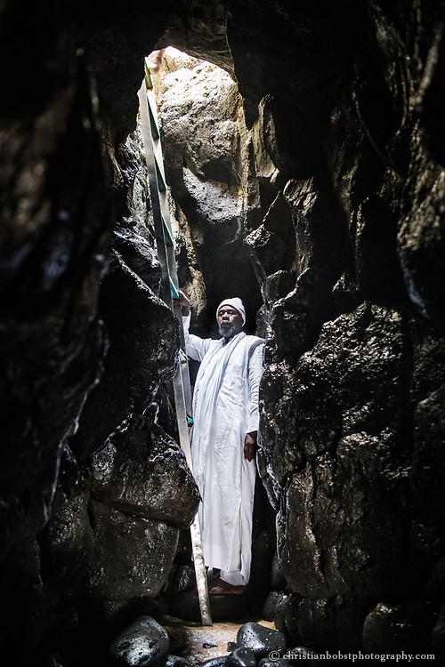 A follower of the Layene Sufi brotherhood poses in a sea grotto in Dakar, where the reborn prophet Muhammad is said to have lived for 20 years. The Layene are another Sufi Brotherhood in Senegal like the Mourides. In 1884, their founder Seydina Limamob Laye claimed to be the Mahdi, the reincarnation of the Prophet Muhammad. The Layene believe that Islam will be reformed through the teachings and light of their founder to find its way back to peace, the original meaning of the word Islam.