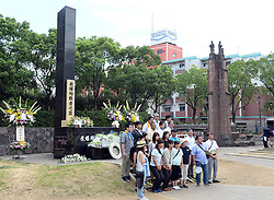 NAGASAKI, Aug. 9, 2016 (Xinhua) -- People pose for photos in front of the monument at the atomic bomb hypocenter to commemorate the 71st anniversary of U.S. atomic bombing, at the Peace Park in Nagasaki, on Aug. 9, 2016. To accelerate Japan's surrender in the World War II, the U.S. forces dropped two atomic bombs on Hiroshima and Nagasaki respectively on Aug. 6 and 9, 1945.  (Xinhua/Ma Ping) (syq) (Credit Image: © Ma Ping/Xinhua via ZUMA Wire)