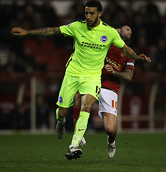 Connor Goldson of Brighton & Hove Albion appears to elbow Henri Lansbury of Nottingham Forest (R) - Mandatory by-line: Jack Phillips/JMP - 11/04/2016 - FOOTBALL - City Ground - Nottingham, England - Nottingham Forest v Brighton and Hove Albion - Sky Bet Championship