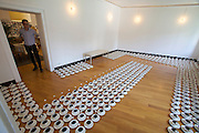 """12th Biennale of Architecture. Luxemburg Pavillion. """"Rock-Paper-Scissors"""", 2010 by KadapaK and guest..""""NONE, 4"""" (800 cups, saucers, sugarcubes.)"""