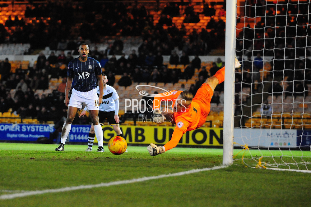 Daniel Bentley of Southend United saves from Carl Dickinson of Port Vale FC during the Sky Bet League 1 match between Port Vale and Southend United at Vale Park, Burslem, England on 26 February 2016. Photo by Mike Sheridan.