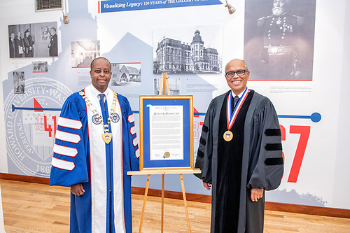 President Wayne A.I. Frederick and honoree Dr. Michael Winston with a Commencement Citation.