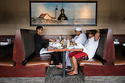 Ahmed Mohamed eats with his father and younger brother at Red Lobster in Irving, Texas on July 15, 2016. (Cooper Neill for The Washington Post)