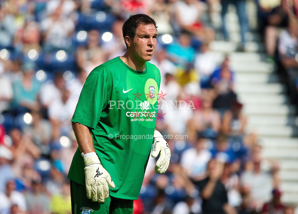PRESTON, ENGLAND - Saturday, July 13, 2013: Preston North End's goalkeeper Thorsten Stuckmann in action against Liverpool during a preseason friendly match at Deepdale. (Pic by David Rawcliffe/Propaganda)