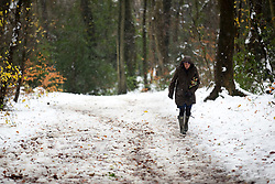 © Licensed to London News Pictures. 11/12/2017. Amersham, UK. A woman walks through the snow in Amersham. Yesterday parts of the south east of England experienced heavy snow, with the home counties experiencing some of the worst conditions. Photo credit : Tom Nicholson/LNP