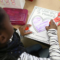 Lauren Wood   Buy at photos.djournal.com<br /> Kaira Scott uses a glue stick while making a valentine during the Valentine's Day party Friday afternoon in Carol Elliott's first grade classroom.