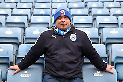 A Huddersfield Town fan in the stands prior to the match