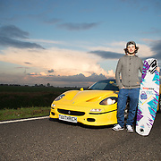 Pro wakeboarder Jorge Gill, 19, poses for a portrait with a £1m Ferrari F50 in Boston Lincolnshire, UK on the 18th November 2014