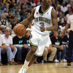 New Orleans Hornets guard Chris Paul #3 drives against the Golden State Warriors in the fourth quarter of their NBA game on April 6, 2008 at the New Orleans Arena in New Orleans, Louisiana.
