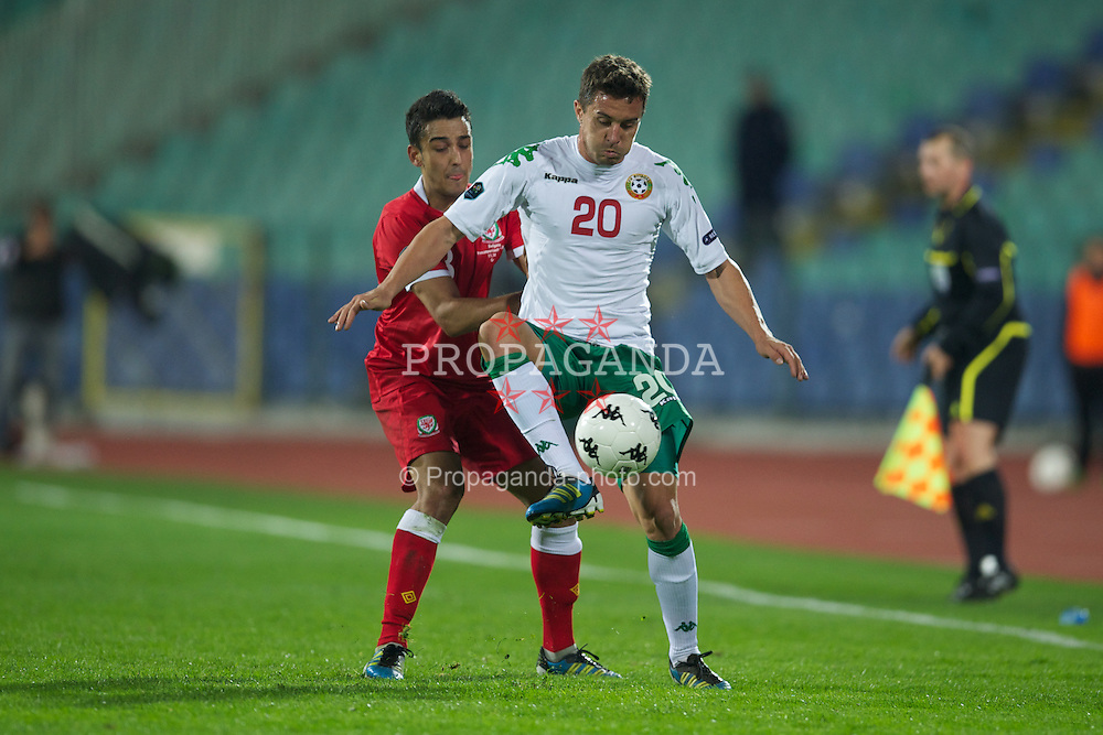 SOFIA, BULGARIA - Tuesday, October 11, 2011: Wales' Neil Taylor in action against Bulgaria's Dimitar Rangelov during the UEFA Euro 2012 Qualifying Group G match at the Vasil Levski National Stadium. (Pic by David Rawcliffe/Propaganda)