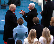 Donald Trump looks back at Melania Trump and his family after he takes the oath of office for the presidency of the United States on January 20,2017..  Vice President Mike Pence is to thr right of Trump<br /> <br /> Photo by Dennis Brack