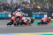 #93 Marc Marquez, Spanish: Repsol Honda Team leads from #9 Danilo Petrucci, Italian: Mission Winnow Ducati Team and #43 Jack Miller, Australian: Alma Pramac Racing Ducati during racing on the Bugatti Circuit at Le Mans, Le Mans, France on 19 May 2019.