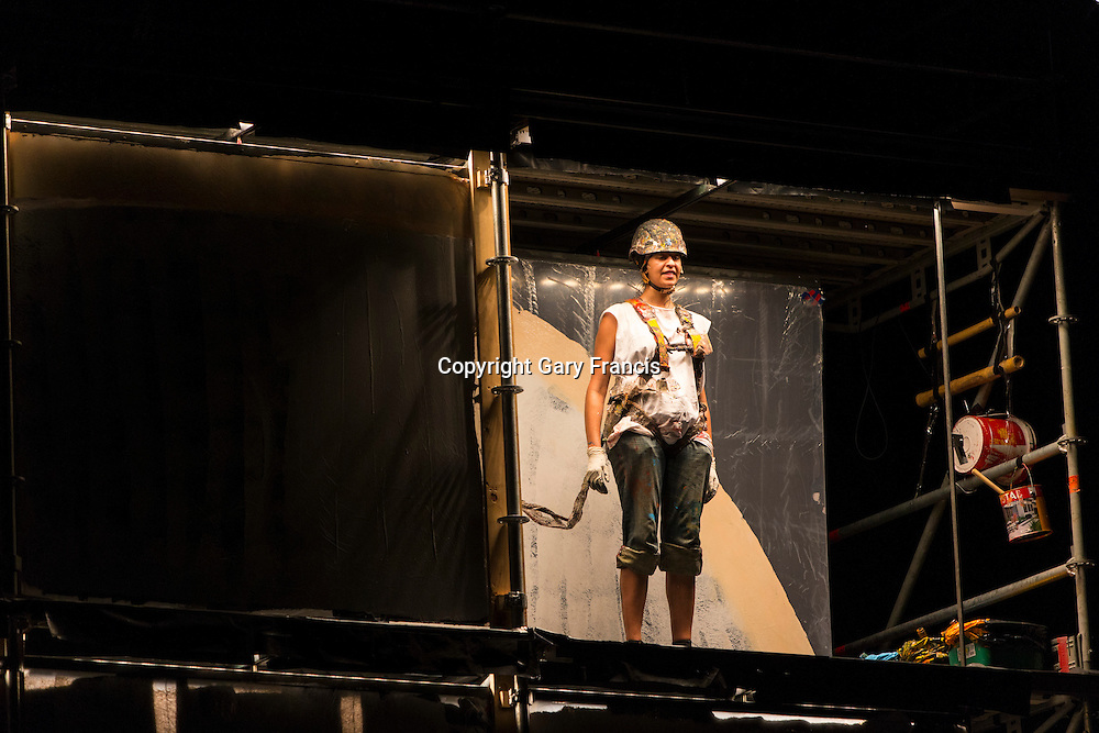 Compagnie Luc Amoros performing Blank Page at a dress rehearsal on the 7 March 2013 before the start of Womadelaide 2013 held between 8 - 11 March 2013 in Adelaide, South Australia...Six artists clamber aboard a 10-metre high scaffolding clad in clear perspex panels and create wild messages - accompanied by a live soundtrack with constantly changing colours, signs, sentences, shadows and lights.