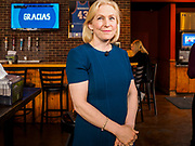 17 APRIL 2019 - DES MOINES, IOWA: US Senator KIRSTEN GILLIBRAND (D-NY), right, talks to Drake University students during a meet and greet with the students at a restaurant in Des Moines. Gillibrand is touring Iowa this week to support her candidacy to be the Democratic nominee for the US Presidency. Iowa traditionally hosts the the first selection event of the presidential election cycle. The Iowa Caucuses will be on Feb. 3, 2020.              PHOTO BY JACK KURTZ