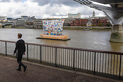 "© Licensed to London News Pictures. 04/09/2019. LONDON, UK. A man passes by during the launch of ""The Ship of Tolerance"" at Tate Modern, Bankside.  The floating installation by Emilia Kabakov (of Russian conceptual artist duo Ilya and Emilia Kabakov) forms part of Totally Thames Festival and will be moored 4 September to 31 October.  The goal of the artwork is to educate and connect the youth of the world through the language of art.  Photo credit: Stephen Chung/LNP"