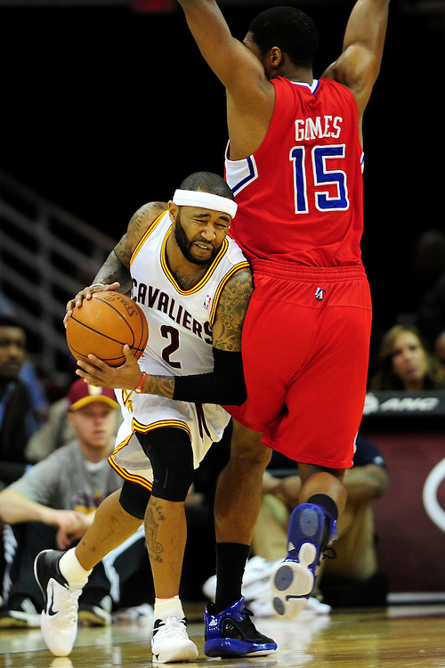 Feb. 11, 2011; Cleveland, OH, USA; Cleveland Cavaliers point guard Mo Williams (2) tries to drive around Los Angeles Clippers small forward Ryan Gomes (15) during the fourth quarter at Quicken Loans Arena. The Cavaliers broke their loosing streak beating the Clipper 126-119 in overtime. Mandatory Credit: Jason Miller-US PRESSWIRE