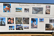 """East Meadow, New York, U.S. 11th September 2013. The Global War on Terror """"Wall of Remembrance"""" a traveling memorial on display in New York for the first time, is at Eisenhower Park on the 12th Anniversary of the terrorist attacks of 9/11. The unique 94 feet long by 6 feet high wall has, on one side, almost 11,000 names of those lost on September 11, 2001, along with heroes and veterans who lost their lives defending freedom of Americans over past 30 years. On the wall's other side is a timeline, with photos, covering 1983 to present day."""