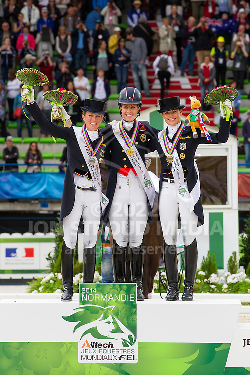 Podium Dressage Grand Prix Special 1. Charlotte Dujardin and Valegro, 2. Helen Langehanenberg and Damon Hill NRW, 3. Kristina Sprehe and Desperados - Grand Prix Special Dressage - Alltech FEI World Equestrian Games&trade; 2014 - Normandy, France.<br /> &copy; Hippo Foto Team - Leanjo de Koster<br /> 25/06/14