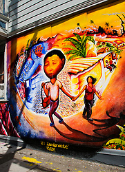 California, San Francisco: Mural in the Mission District painted by Joel Bergner, titled El Inmigrante..Photo #: 26-casanf78550.Photo © Lee Foster 2008.  Note: For travel editorial illustration use only.  Not available for commercial use.  Copyright to the art object remains with the artist, Joel Bergner.  Contact the artist through Precita Eyes www.precitaeyes.org, 415-285-2287.