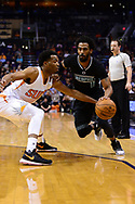 Jan 30, 2017; Phoenix, AZ, USA; Memphis Grizzlies guard Mike Conley (11) handles the ball against Phoenix Suns forward Marquese Chriss (0) in the first half of the NBA game at Talking Stick Resort Arena. The Memphis Grizzlies won 115-96. Mandatory Credit: Jennifer Stewart-USA TODAY Sports
