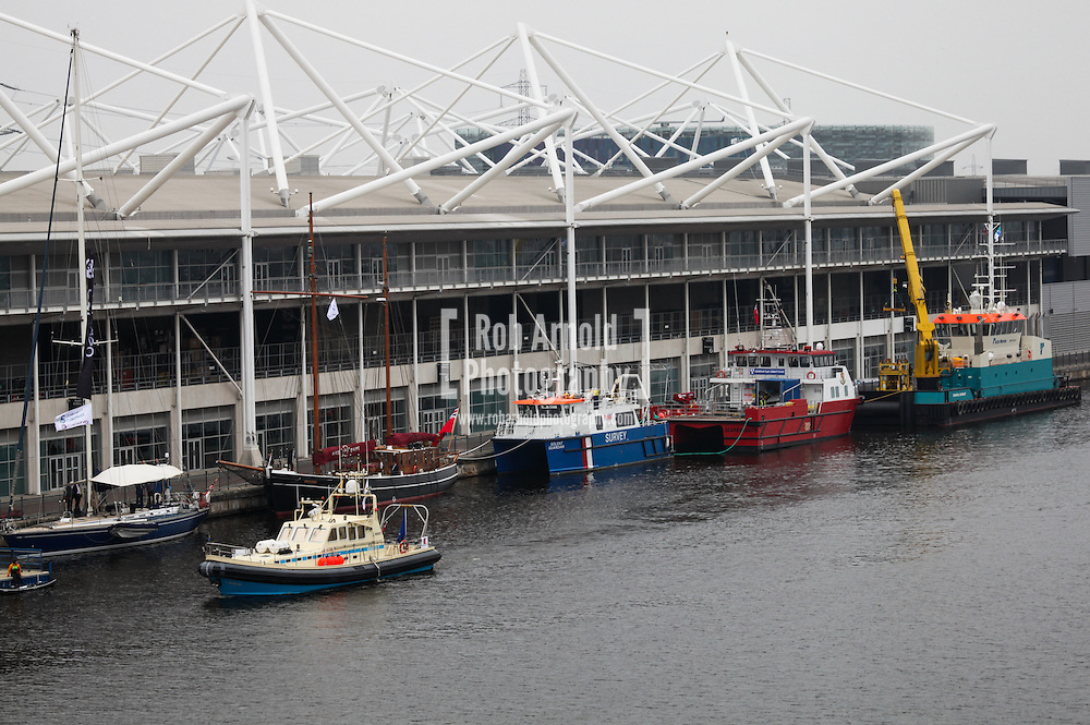 © Rob Arnold 11/03/2014. London, UK. Vessels on the quayside at Oceanology International (OI) 2014. The event is the world's largest exhibition for marine science and technology, held at London's ExCeL Centre. The three day exhibition provides an opportunity for industry, academic and government organisations to share knowledge and promote improvements in technology and strategy used for operating, surveying, protecting and exploiting resources in the oceans of the world. Photo Credit : Rob Arnold