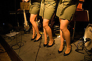 Legs of the singers of Daddy's Darlings, a retro band performing songs of the Second World War. Antwerp, Belgium, 2006